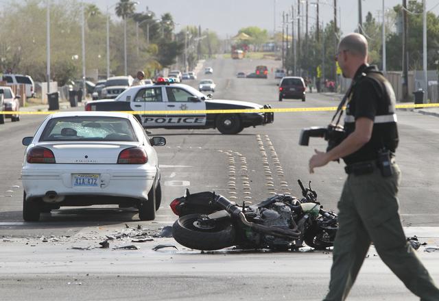Las Vegas police investigate a crash between a motorcycle and a car at Pecos and Gowan roads on March 2, 2016, in North Las Vegas. Bizuayehu Tesfaye/Las Vegas Review-Journal Follow @bizutesfaye