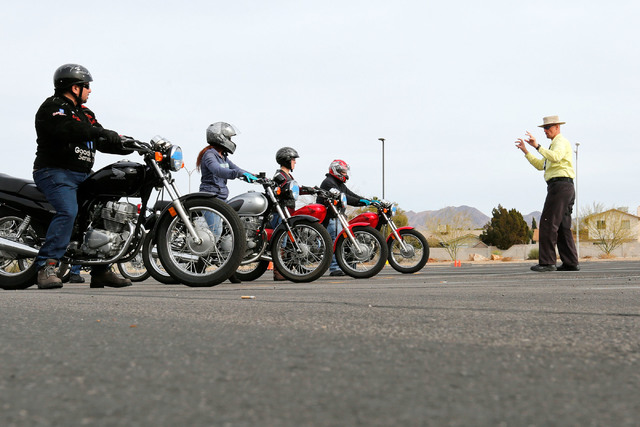 """Instructor Mike """"Pilot"""" Nelson, right, talks with participants during a College of Southern Nevada motorcycle safety course at the college's Henderson campus on Sunday, Feb. 5, 2017. (Chitose Suzu ..."""