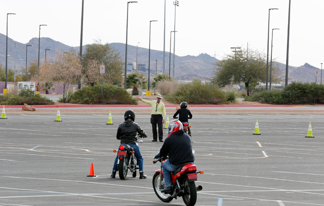 """Instructor Mike """"Pilot"""" Nelson, center, directs participants during a College of Southern Nevada motorcycle safety course at the college's Henderson campus on Sunday, Feb. 5, 2017. (Chitose Suzuki ..."""