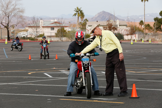 "Instructor Mike ""Pilot"" Nelson, right, talks with Jason Craft of Las Vegas during a College of Southern Nevada motorcycle safety course at the college's Henderson campus on Sunday, Feb. 5, 2017. ( ..."