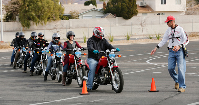 Instructor Patrick Soles, right, directs participants during a College of Southern Nevada motorcycle safety course at the college's Henderson campus on Sunday, Feb. 5, 2017. (Chitose Suzuki/Las Ve ...