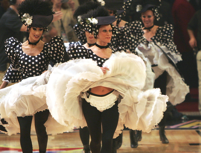 Dancers from the Folies Bergere show at theTropicana hotel-casino perform during a time out on Sunday, Feb. 18, 2007 during the All-Star basketball game at the Thomas and Mack Center in Las Vegas. ...