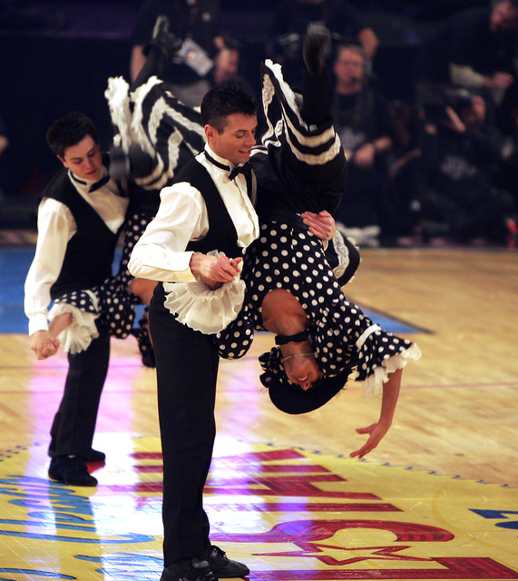 Dancers from the Folies Bergere show at theTropicana hotel-casino perform during a time out on Sunday, Feb. 18, 2007 during the NBA All-Star basketball game at the Thomas and Mack Center in Las Ve ...