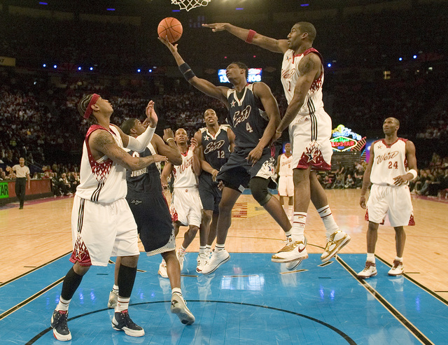 Chris Bosh, in blue, goes up for a layup against Amare Stoudemire during the NBA All-Star game at the Thomas & Mack Center in Las Vegas Sunday, Feb. 18, 2007. (John Locher/Las Vegas Review-Jou ...