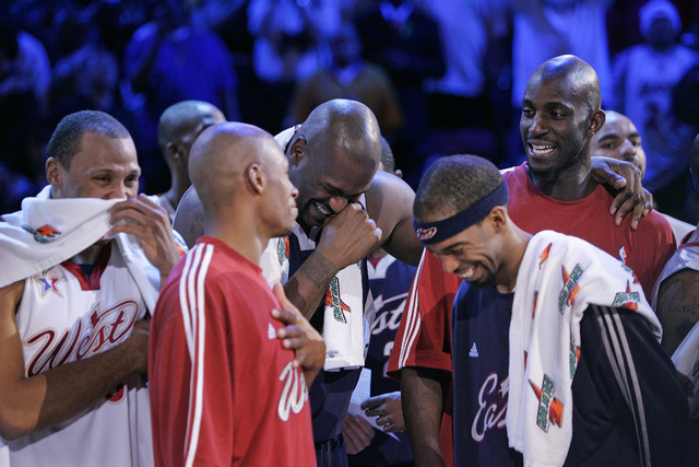 Shaquille O'Neal, center, laughs with other players after the finish of the NBA All-Star game at the Thomas & Mack Center in Las Vegas Sunday, Feb. 18, 2007. (John Locher/Las Vegas Review-Journal)