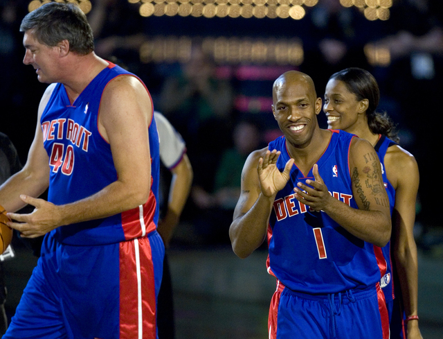 Team Detroit, from left, NBA legend Bill Laimbeer, WNBA player Swin Cash and current Detroit Pistons player Chauncey Billups celebrate Billups sinking a half court shot in the Shooting Stars compe ...