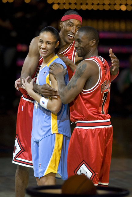 Team Chicago, from left, Chicago Sky of the WNBA player Candace Dupree, NBA legend Scottie Pippen and current Chicago Bulls player Ben Gordon celebrate winning the first round of the Shooting Star ...