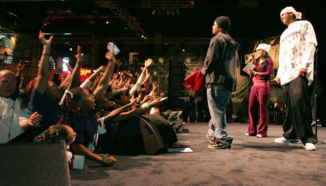 Carmelo Anthony, right, is greeted by fans at the Jordan Brand Experience at Sports Center Las Vegas February 16. Emceeing the event are actress Meagan Good and comedian Alex Thomas. 1500 Clark Co ...