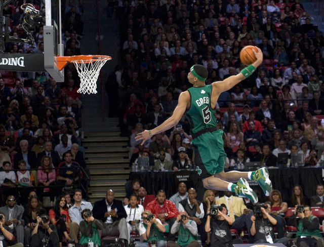 Gerald Green of the Boston Celtics flies over a table on his final dunk to win the Slam-dunk competition during NBA All-Star festivities at the Thomas & Mack Center Saturday, Feb. 17, 2007. (K ...