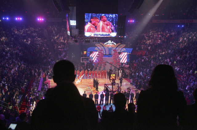 Basketball fans stand as Clint Holmes sings the National Anthem on Sunday, Feb. 18, 2007 during the All-Star basketball game at the Thomas and Mack Center in Las Vegas. (John Gurzinski/Las Vegas R ...