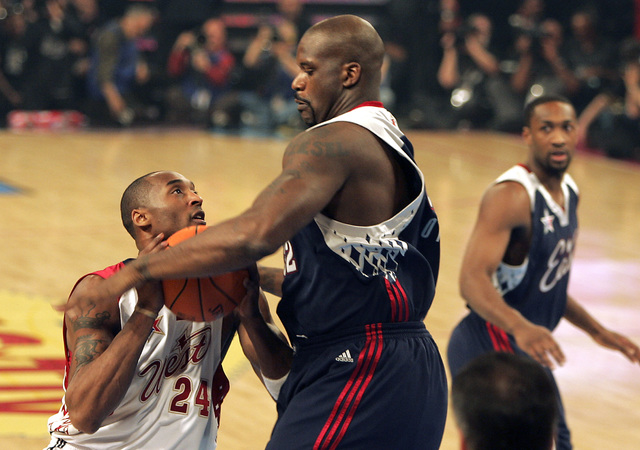 NBA Eastern Conference player (L) Shaquille O'Neal blocks  NBA Western Conference player (R) Kobe Bryant as he tries to score during the All-Star basketball game at the Thomas and Mack Center in L ...