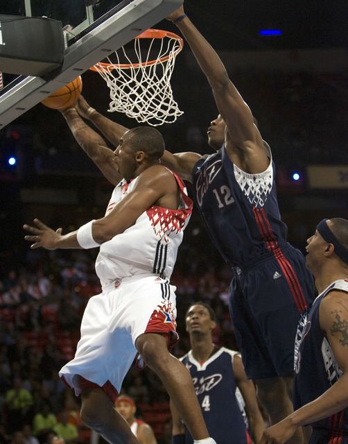 West guard Kobe Bryant of the Los Angeles Lakers shoots a reverse layup past Dwight Howard of Orlando during the NBA All-Star Game at the Thomas & Mack Center Sunday, Feb. 18, 2007. (K.M. Cann ...