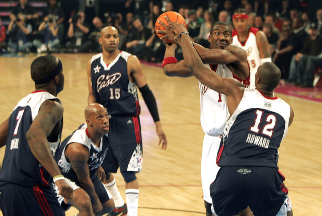 NBA Eastern Conference player (R) Dwight Howard tries to grab the ball from  NBA Western Conference player (L) Amare Stoudemire during the All-Star basketball game at the Thomas and Mack Center in ...