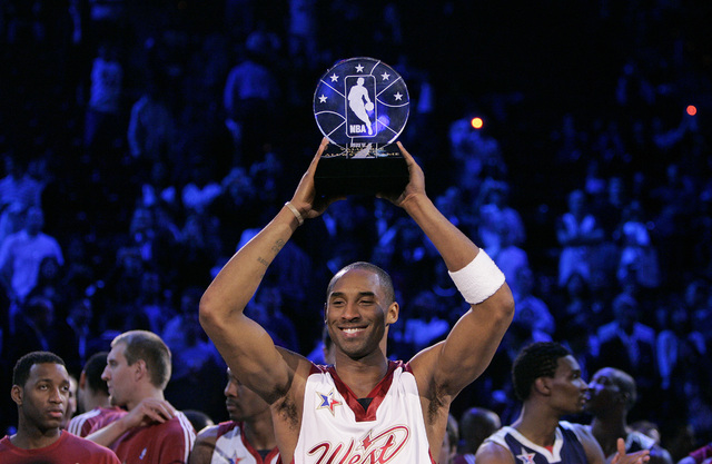 Kobe Bryant holds up the MVP trophy during the NBA All-Star game at the Thomas & Mack Center in Las Vegas Sunday, Feb. 18, 2007. (John Locher/Las Vegas Review-Journal)