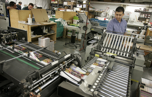 Jose Barba works at the folding machine at A & B Printing in Las Vegas Tuesday, Feb. 13, 2007. A & B Printing has been printing materials for the NBA for the All-Star game. (John Locher/La ...