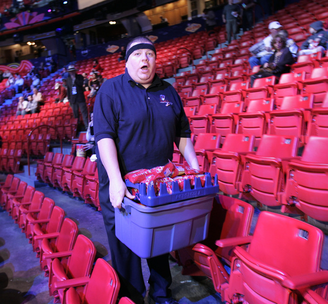 """Theodore """"Ted"""" Gifford sells peanuts and water before the start of the NBA All-Star game at the Thomas & Mack Center in Las Vegas Sunday, Feb. 18, 2007. (John Locher/Las Vega ..."""