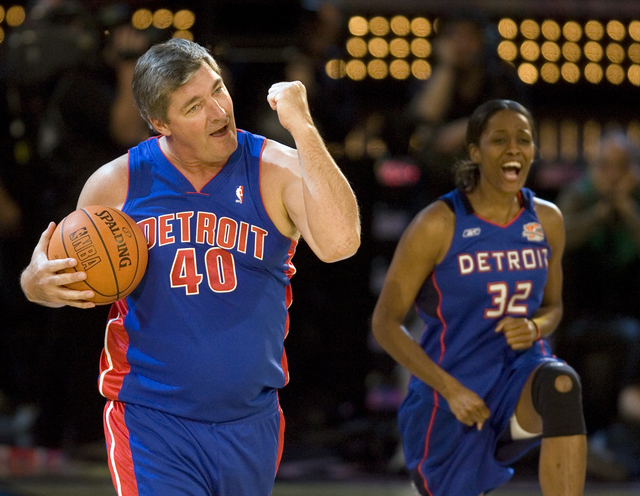 NBA legend Bill Laimbeer, left, and Swin Cash of the WNBA celebrate their teammate, current NBA player Chauncey Billups, sinking a half court shot in the Shooting Stars competition during NBA All- ...