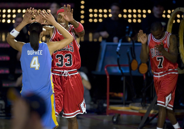 Team Chicago, from left, Chicago Sky of the WNBA player Candace Dupree, NBA legend Scottie Pippen and current Chicago Bulls player Ben Gordon celebrate after thinking they won the Shooting Stars c ...