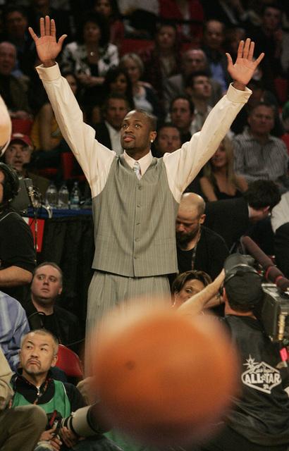 Dwyane Wade cheers as he watches Jason Kapono shoot during the NBA All-Star Three-Point Shootout at the Thomas & Mack Center in Las Vegas Saturday, Feb. 16, 2007. (John Locher/Las Vegas Review ...