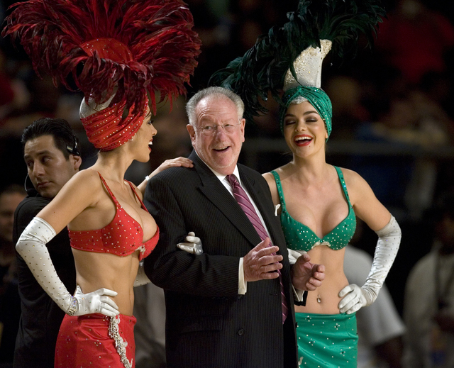 Mayor Oscar Goodman jokes with showgirls prior to being introduced during halftime festivities during the NBA All-Star Celebrity Game at Mandalay Bay Friday, Feb. 16, 2007. The West beat the East  ...