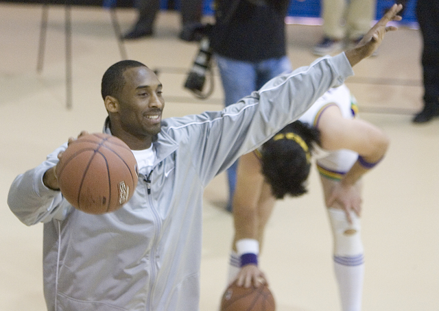 Los Angeles Lakers All-Star Kobe Bryant celebrates his victory over NBA '07's Billy Joe Cuthbert in a basketball drill at the Lied Memorial Boys & Girls Club fans, Friday afternoon, February 1 ...