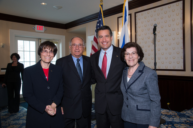Esther Finder, right, is shown with Holocaust survivors Phil and Raymonde Fiol, along with Gov. Brian Sandoval. (Courtesy)