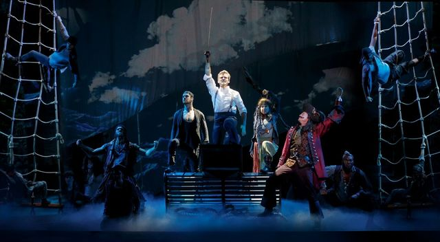"""James M. Barrie (Kevin Kern) leads a piratical charge against Capt. Hook (Tom Hewitt) in """"Finding Neverland,"""" opening Tuesday at The Smith Center. (Carol Rosegg/Smith Center for the Performing ..."""