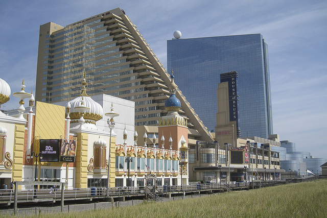 The north end of the Atlantic City Boardwalk is seen on Sept. 11, 2014. The Trump Taj Mahal, left, filed for bankruptcy on Sept. 9. The Showboat (center) closed on Aug. 31. Revel (right) closed on ...