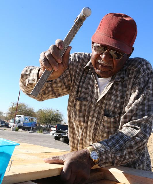 James Johnson, 80, volunteer at Zion Choice Neighborhood Community Garden Park builds garden plots on Wednesday, Feb. 1, 2017, in North Las Vegas. (Bizuayehu Tesfaye/Las Vegas Review-Journal) @biz ...