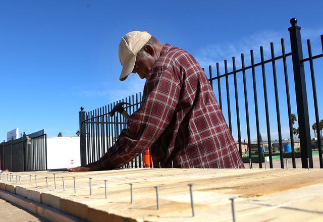 Harry Dodd, 77, volunteer at Zion Choice Neighborhood Community Garden Park builds garden plots on Wednesday, Feb. 1, 2017, in North Las Vegas. (Bizuayehu Tesfaye/Las Vegas Review-Journal) @bizute ...