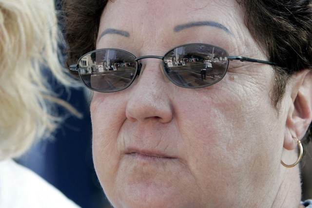 Norma McCorvey, the Jane Roe behind the landmark 1973 Roe v. Wade Supreme Court decision legalizing abortion, watches as anti-abortion activists line the street in front of Mississippi's sole abor ...