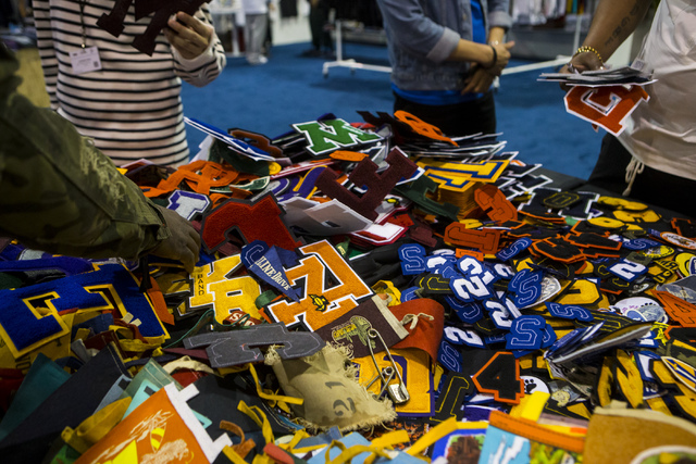 Attendees sift through vintage patches at the Off Price Expo at the Sands Expo and Convention Center in Las Vegas on Monday, Feb. 20, 2017. (Miranda Alam/Las Vegas Review-Journal) @miranda_alam