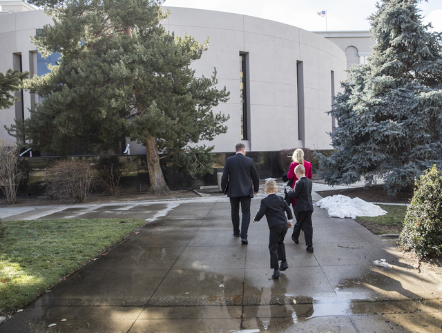 Wayne, left, Lucas and Kellen Thorley and Kim Perondi walk into the Legislative Building during the first day of the Nevada Legislative session on Monday, Feb. 6, 2017, in Carson City. (Benjamin H ...