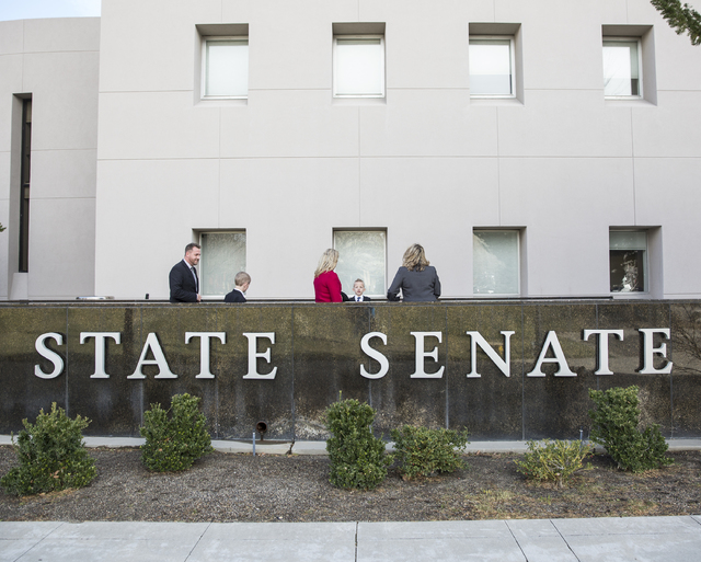 Wayne, left, Kellen and Lucas Thorley, with Kim Perondi and Cadence Matijevich, walk into the Legislative Building during the first day of the Nevada Legislature on Monday, Feb. 6, 2017, in Carson ...