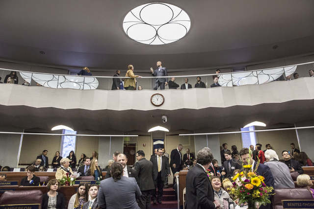Nevada Senate Majority Leader Aaron Ford, top/middle, interacts with guests before the start of the first day of the Nevada Legislative session on Monday, Feb. 6, 2017, at the Legislative Building ...