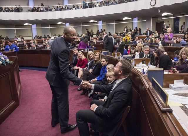 Nevada Senate Majority Leader Aaron Ford, left, shakes hands with Wayne Thorley during the first day of the Nevada Legislative session on Monday, Feb. 6, 2017, at the Legislative Building, in Cars ...