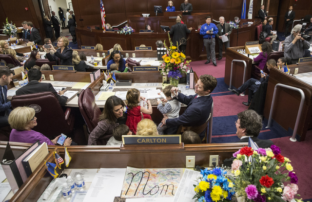 Jeff Thompson, right, takes family photos before the start of the first day of the Nevada Legislative session on Monday, Feb. 6, 2017, at the Legislative Building, in Carson City. (Benjamin Hager/ ...