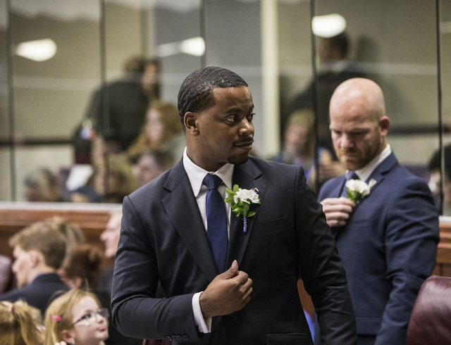 Assemblyman William McCurdy II, left, straightens his corsage during the first day of the Nevada Legislative session on Monday, Feb. 6, 2017, at the Legislative Building, in Carson City. (Benjamin ...