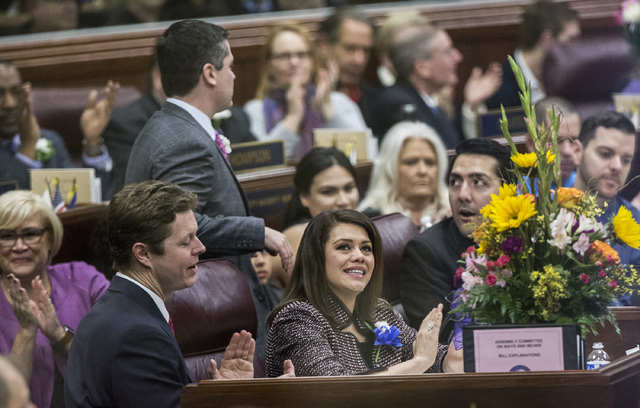 Assemblywoman Teressa Benitez-Thompson claps for Assemblymen Jason Frierson during the first day of the Nevada Legislative session on Monday, Feb. 6, 2017, at the Legislative Building, in Carson C ...