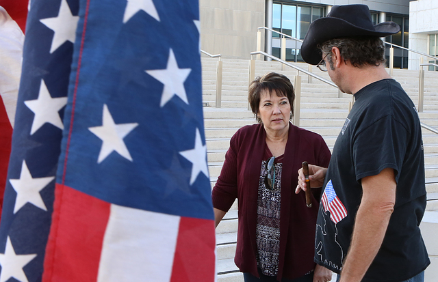 Carol Bundy, wife of Nevada rancher Cliven Bundy, and Greg Whalen protest outside the Lloyd George U.S. Courthouse on Thursday, Feb. 9, 2017, in Las Vegas. Opening statements began Thursday in the ...