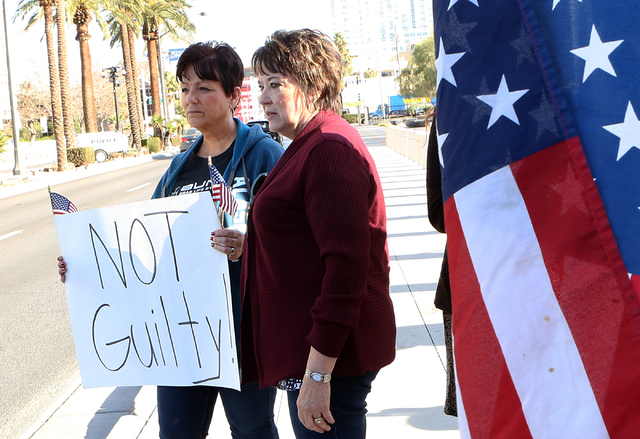 Carol Bundy, right, wife of Nevada rancher Cliven Bundy, and Margaret Houston protest outside the Lloyd George U.S. Courthouse on Thursday, Feb. 9, 2017, in Las Vegas. Opening statements began Thu ...