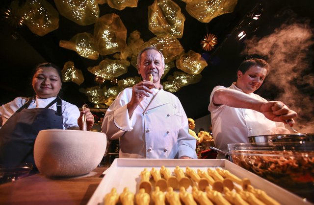 Chef Wolfgang Puck, flanked by Executive Pastry Chef Monica Ng, left, and Eric Klein, vice president of culinary for Wolfgang Puck Catering, during a media preview for the 89th Academy Awards' Gov ...