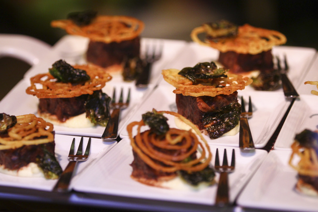 Moroccan spiced wagyu short rib with parmesan funnel cake prepared by Wolfgang Puck Catering during a media preview for the 89th Academy Awards' Governors Ball in Hollywood, Calif. on Thursday, Fe ...