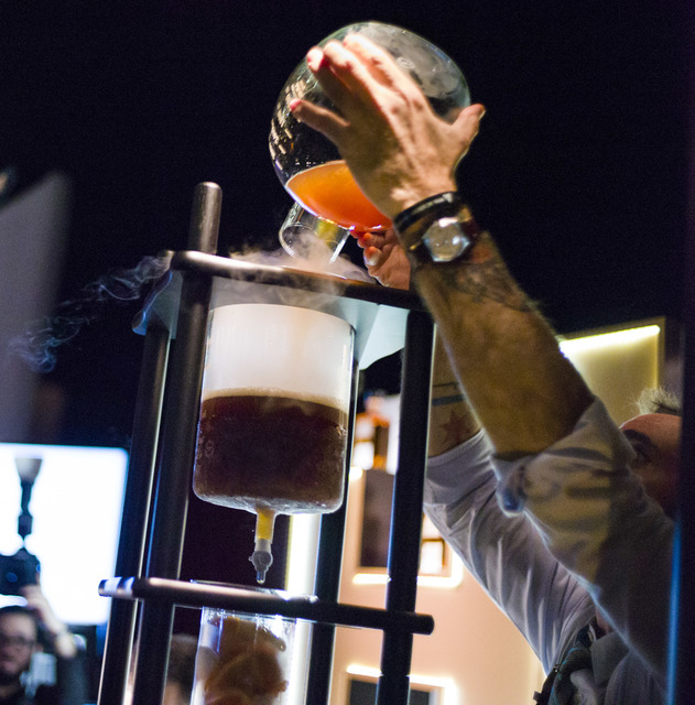 Mixologist Charles Jolly works on making cocktails featuring The Hilhaven Lodge whiskey during a media preview for the 89th Academy Awards' Governors Ball in Hollywood, Calif. on Thursday, Feb. 16 ...