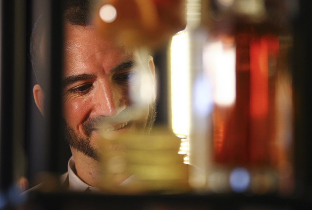 Mixologist Charles Jolly talks about cocktails featuring The Hilhaven Lodge whiskey during a media preview for the 89th Academy Awards' Governors Ball in Hollywood, Calif. on Thursday, Feb. 16, 20 ...