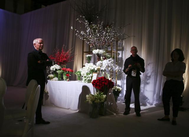 Celebrity florist Mark Held of Mark's Garden, left, during a media preview for the 89th Academy Awards' Governors Ball in Hollywood, Calif. on Thursday, Feb. 16, 2017. (Chase Stevens/Las Vegas Rev ...