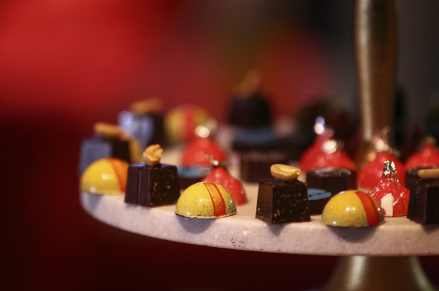 Artisanal chocolate bonbons, featuring classic movie theater flavors such as Sour Patch Kids, Red Hots and more by Wolfgang Puck Catering during a media preview for the 89th Academy Awards' Govern ...