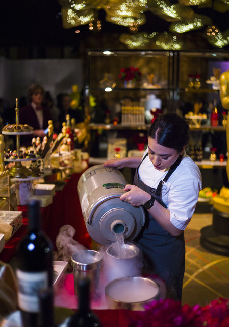 Liquid nitrogen, used with a deconstructed black forest cake, is poured during a media preview for the 89th Academy Awards' Governors Ball in Hollywood, Calif. on Thursday, Feb. 16, 2017. (Chase S ...