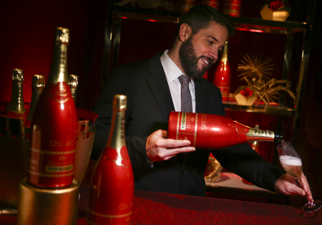 Benoit Collard, global executive director of Piper-Heidsieck , pours the Piper-Heidsieck Cuvee Brut magnum during a media preview for the 89th Academy Awards' Governors Ball in Hollywood, Calif. o ...