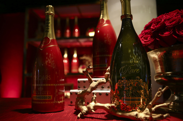 The Piper-Heidsieck Cuvee Brut magnum, left, during a media preview for the 89th Academy Awards' Governors Ball in Hollywood, Calif. on Thursday, Feb. 16, 2017. (Chase Stevens/Las Vegas Review-Jou ...